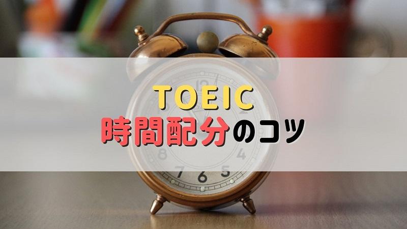 机の上に置かれた茶色のベル音アナログ目覚まし時計